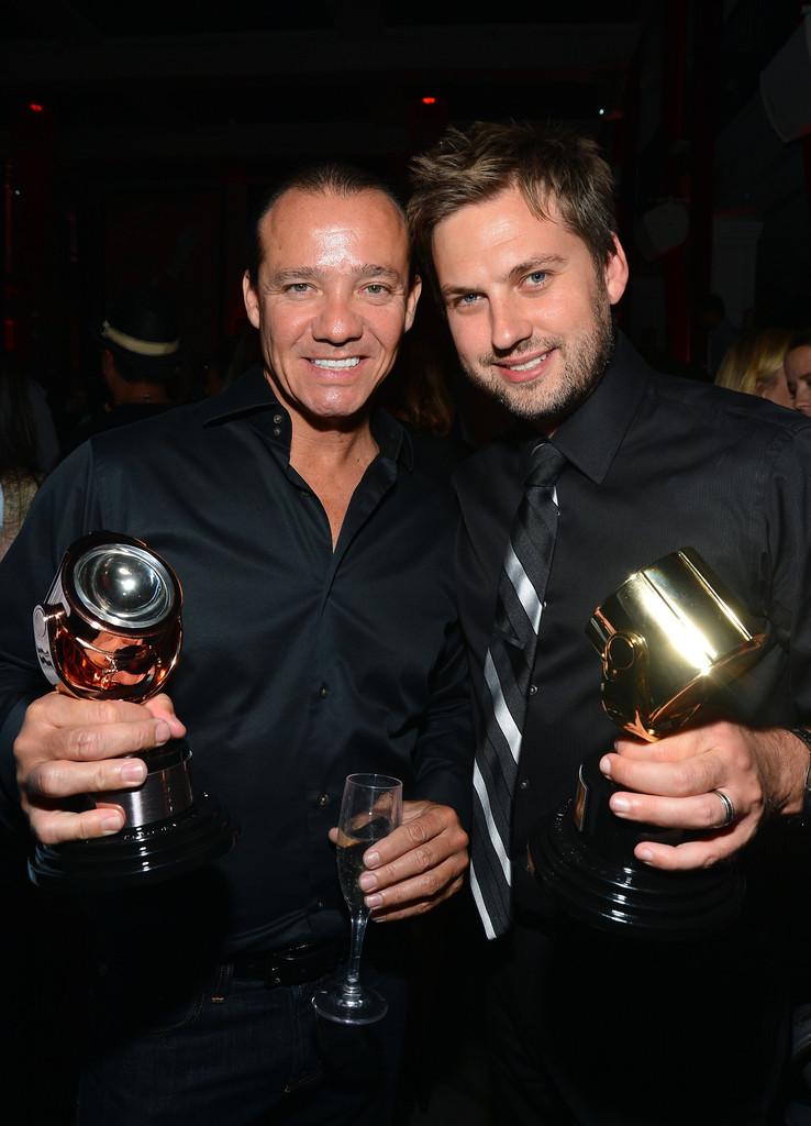 CEO Ryan Cramer & VP Sean Alatorre of Neuron Syndicate hold their 2012 Gold & Bronze Key Art Awards